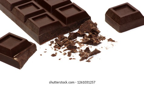 Broken chocolate bar isolated on white.
