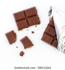 Broken chocolate bar isolated on white background. Top view.
