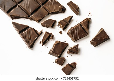 Broken chocolate bar, white background, top view