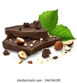 Broken chocolate blocks with hazelnuts or filberts on white background