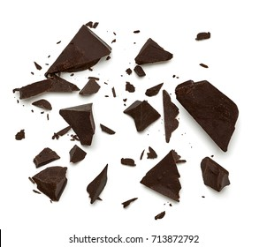 Broken chocolate parts from top view isolated on white background