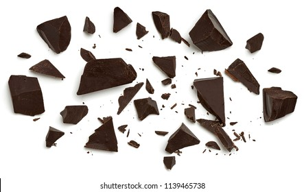 Broken chocolate pieces  or morsels / cracked chocolate parts isolated on white background