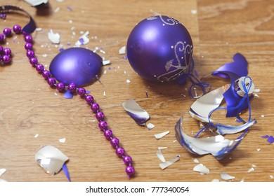 Broken Christmas purple  ball on the floor