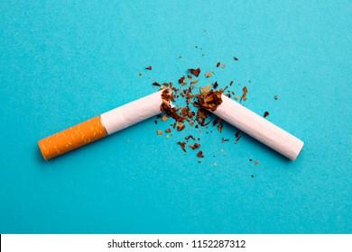 broken cigarette on a blue background