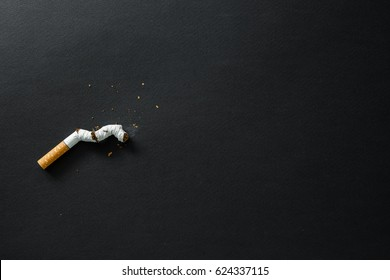 Broken cigarette on a dark background. quit Smoking