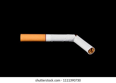 broken cigarette on isolated black background