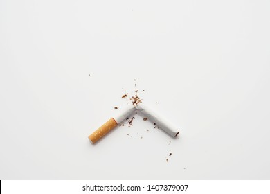 Broken cigarette on white background ,  World No Tobacco Day Tobacco and lung health concept .