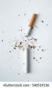 broken cigarette on white background to symbolize quit smoking