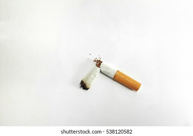 Broken cigarette symbolic to stop smoking and world no tobacco day isolated on white background