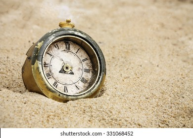 broken clock on sand
