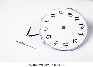 Broken clock on the white wall clocks (isolated).