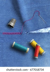 Broken cloth, thimble and threads