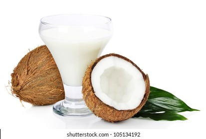 Broken coconut with juice in glass isolated on white