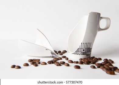 broken coffee cup and coffee beans