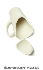 Broken Coffee Mug Lying on White Background