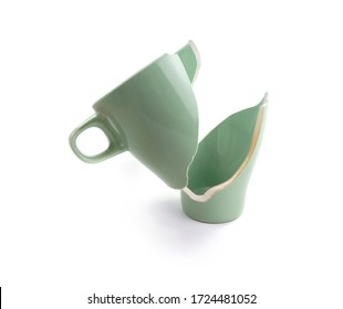 Broken coffee mug on white background, broken cup pieces, Broken relationship and Parting concept