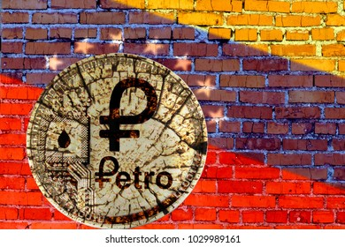 Broken coin cryptocurrency Petro on background brick wall with flag of Venezuela.