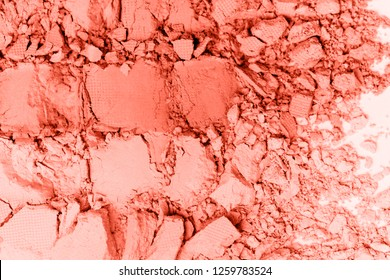 A broken colored in color of year 2019 Coral eye shadow make up palette. flat lay. Copy space for your text. Creative fashion and beauty living coral concept.