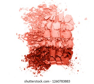 A broken colored in color of year 2019 Living Coral eye shadow make up palette. flat lay. Copy space for your text. Creative fashion and beauty living coral concept.