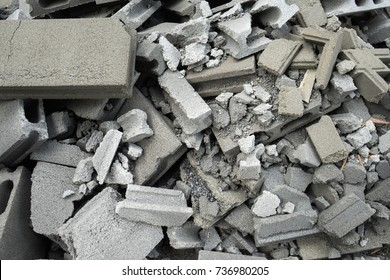 Broken concrete block, construction waste.