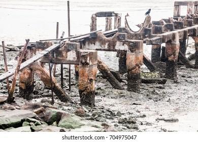 Broken concrete bridge on top of mud