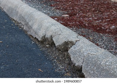 Broken Concrete Curb Near Asphalt