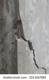 Broken concrete pole. Cause damage and dangerous to house. Concept of destruction of infrastructure.