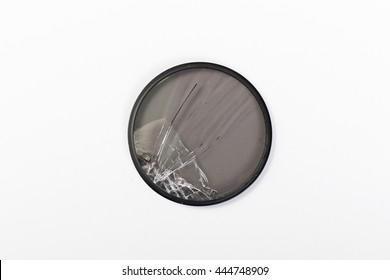 broken CPL lens isolated on white background