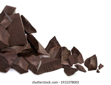 Broken, cracked or crushed dark chocolate parts pile from side view isolated on white background including clipping path