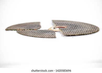 broken cracked cutting wheels abrasive disc isolated white background photo close up side view