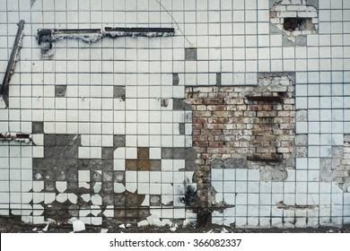 Broken cracked light blue tile wall texture background. Vintage effect.