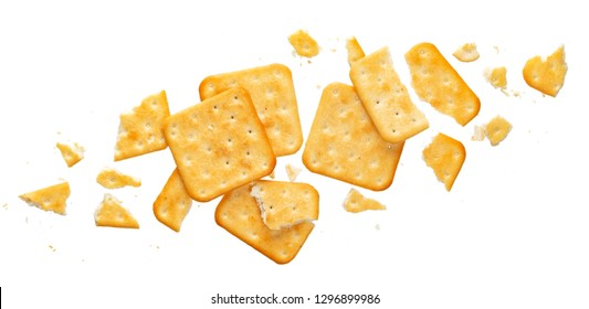 Broken cracker isolated on white background. Crushed dry cracker cookies isolated with clipping path, top view