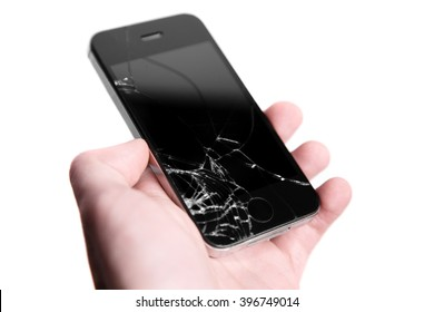 broken crashed glass on phone in hand on white background