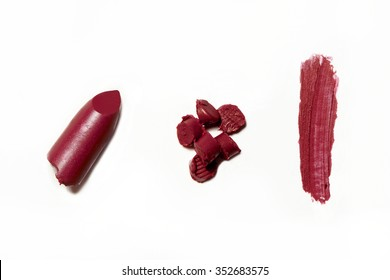 broken crumbled and smashed red fuchsia lipstick