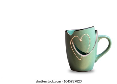 Broken in a cup isolated on white background.Green Heart Cup Cracked.Heart broken represents heartbreak.