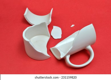 broken cup on bright background