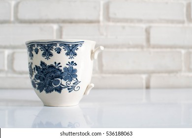 Broken cup on white background. Concept of unperfected but wonderful.