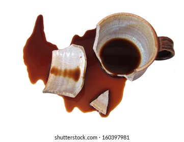Broken cup with spilled coffee