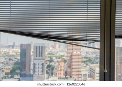 Broken curtain, Louvers , shade, blind, shutters, jalousie on tall building that Select focus point.