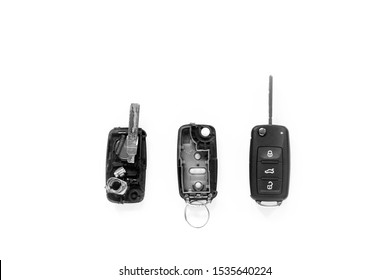 Broken or damaged remote key fob of any vehicle car  locksmith service center. Flat lay isolated on white background.- Image