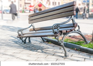 Broken and damaged wooden bench on the street, vandalism concept