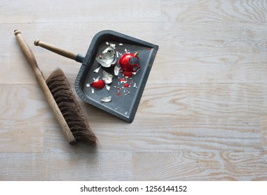 A broken decorations and dustpan and brush