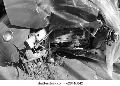 The broken and destroyed car.