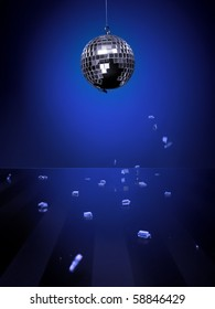 Broken disco-ball isolated on blue background with pieces of mirror falling down on a shiny glass floor