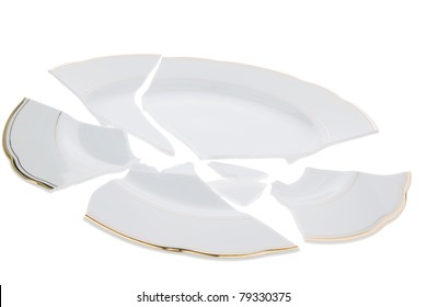 A broken dish is on a white background.