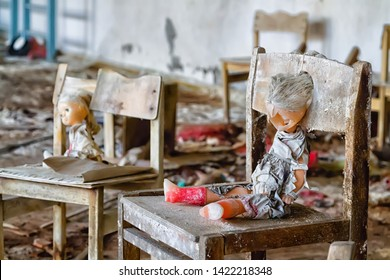 Broken doll in Chernobyl and Pripyat school and kindergarten. Left after nuclear power plant disaster. The exclusion zone, Ukraine