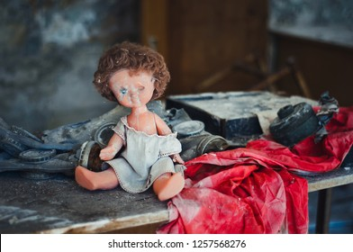 Broken doll during evacuation after Chernobyl catastrophe from Pripyat
