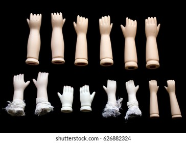 Broken Doll Hand and Arms on Black Background