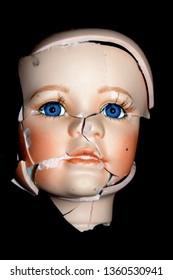Broken Doll Head Face On Black Background