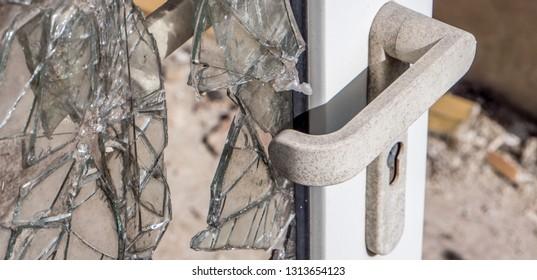 Broken door after burglary